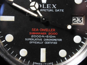 Red Submariner winder close up